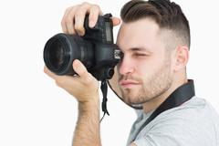 Close-up of photographer with photographic camera - stock photo