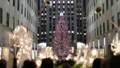 Rockefeller Center Christmas tree in New York City tilt down Stock Footage