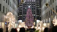 Stock Video Footage of Rockefeller Center Christmas tree in New York City tilt down