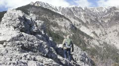Hiker ascending to the mount top Stock Footage