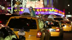 Radio City Christmas holiday season taxi traffic in New York City - stock footage