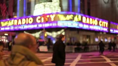Radio City Christmas holiday season crowd people walking in New York City Stock Footage