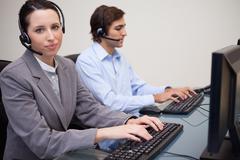 Two call center operators - stock photo