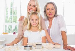 Stock Photo of Mothers and daughters cooking together