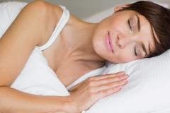 Pretty woman in bed Stock Photos