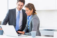 Stock Photo of Couple using laptop before work