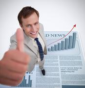 Smiling businessman giving thumb up - stock photo