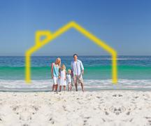 Stock Photo of Standing family with drawing house