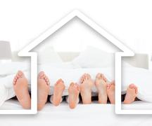 Feet family in the duvet with house illustration Stock Illustration