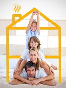 Stock Photo of Family having fun with yellow drawing house