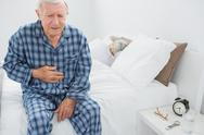 Elderly man suffering with belly pain Stock Photos