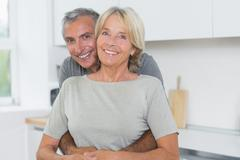 Happy mature couple hugging - stock photo
