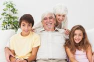 Grandparents with grandchildren on the sofa Stock Photos