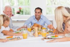 Happy family at thanksgiving - stock photo