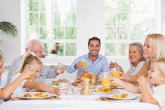 Family toasting at thanksgiving - stock photo