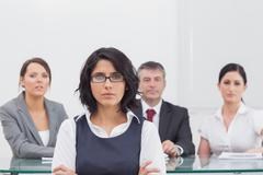 Four business people with serious expressions Stock Photos