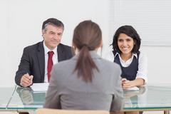 Business people talking and smiling in a small meeting - stock photo