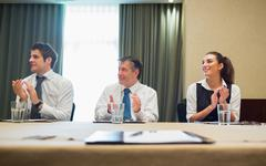 Business people clapping after presentation - stock photo