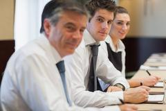 Happy business people at a meeting - stock photo