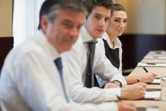 Smiling businesswoman in meeting Stock Photos
