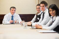 Smiling business team at meeting Stock Photos