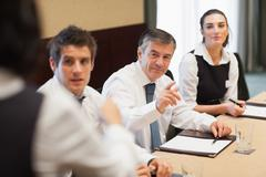 Stock Photo of Man has question during business presentation