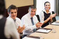 Stock Photo of Business people clapping after a presentation