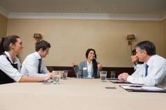 Businesswoman talking at meeting Stock Photos