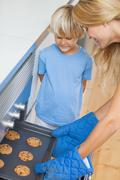 Mother and her son baking cookies - stock photo