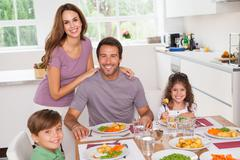 Stock Photo of Family smiling at the dinner table