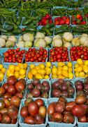 display of fresh produce tomatoes and peppers - stock photo