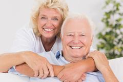 Happy old couple portrait hugging - stock photo