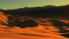 Timelapse Sunrise or Sunset over Gold Desert Sand Dunes Stock Footage