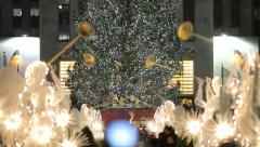 Rockefeller Center Christmas tree in New York City 25p rack focus Stock Footage