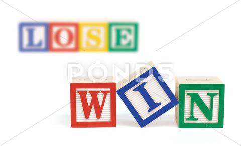 Stock photo of win lose alphabet blocks