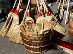 Big and small brooms Stock Photos