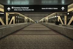 Airport night currency exchange British Airways terminal - stock photo