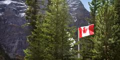 Canadian Flag In National Park - stock photo