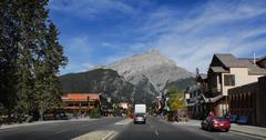 Road Through Pretty Mountain Town - stock photo