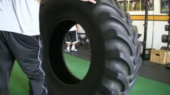 Tractor tire as a gym equipment Stock Footage