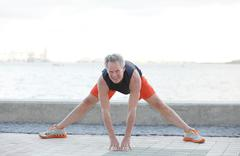 Stock image of a man stretching - stock photo