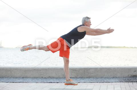 Stock photo of Man in a balancing pose