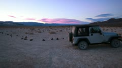 Jeep with beautiful pink desert sunrise sunset in Death Valley, California. Stock Footage