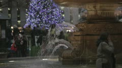 Bryant Park Fountain - Medium with Christmas Tree in BG - Night (NO GRADING) Stock Footage