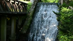 Brook stream flow run old retro water mill cascade zoom out Stock Footage