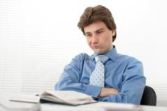 portrait of a pensive young businessman - stock photo