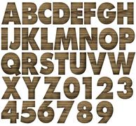 Teak wood alphabets with letters and numbers. Stock Photos