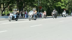 Bikers ride motorcycles in birzai and people watch Stock Footage