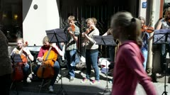 Young people play violin in street music day Stock Footage