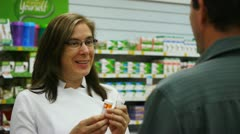 Pharmacist counselling customer Stock Footage